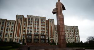 A statue of  Lenin in front of Transnistria  parliament building in Tiraspol. Photograph: Daniel Mihailescu/AFP via Getty Images