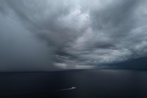 RUNNING FOR IT: A yacht sails in the Mediterranean Sea ahead of an approaching rainstorm, near the city of Nice on the French Riviera, southern France. Photograph: Valery Hache/AFP/Getty