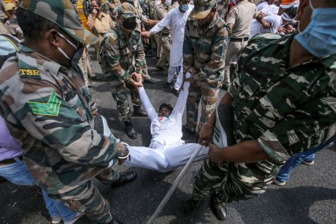 TAKEN IN HAND: Indian security personnel detain Youth Congress activists as they shout slogans against Indian prime minister Narendra Modi during a protest against the introduction of new agricultural measures, in New Delhi, India. Farmers in the states of Punjab and Haryana intend to intensify their protests against the government measures. Photograph: Rajat Gupta/EPA
