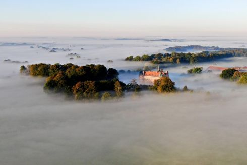 ETHEREAL BEAUTY: An aerial view of Egeskov castle amid morning fog, on the island of Funen, Denmark. Photograph: Michael Bager/Ritzau Scanpix/AFP/Getty