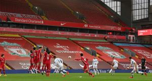 Leeds United in action against  Liverpool at Anfield on September 12th. 'The prime minister seems to think that we're all okay if the Premier League is still happening.' Photograph: Paul Ellis/AFP via Getty Images