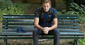 Russian opposition leader Alexei Navalny sitting on a bench in Berlin. Photograph: @navalny/AFP via Getty
