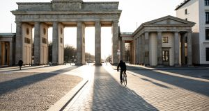 A lone biker at Berlin's Brandenburg Gate. Services sentiment indices fell in Germany and France, the euro zone's two largest economies. Photograph: iStock