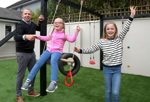 Noel Kelly with his daughters Elena (7) and Lauren (9) at their home in Tuam, Co Galway. Photograph: Joe O'Shaughnessy