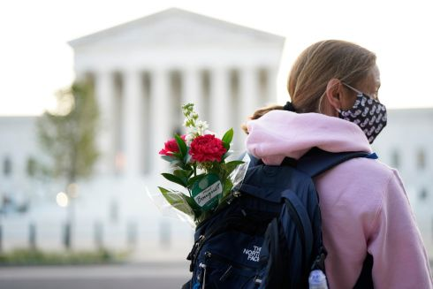IT'S PERSONAL: Waiting with flowers to see the body of Justice Ruth Bader Ginsburg lying in repose at the Supreme Court, in Washington DC, US. Photograph: Doug Mills/New York Times