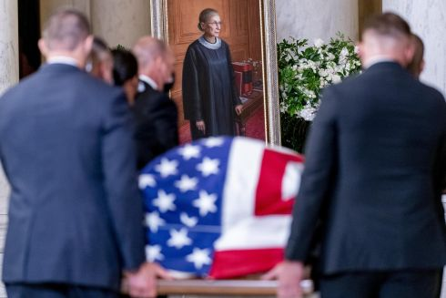 WATCHFUL EYE: Late Supreme Court Justice Ruth Bader Ginsburg's casket is carried into the Great Hall of the Supreme Court, with her framed likeness in the background. Photograph: Andrew Harnik/AP Photo/Bloomberg