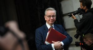 Michael Gove: he said the permit system would be enforced by police and by number plate recognition. Photograph:  EPA/Neil Hall