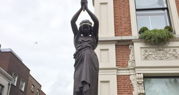 One of the  statues,  removed by the Shelbourne Hotel - which will now be put back.