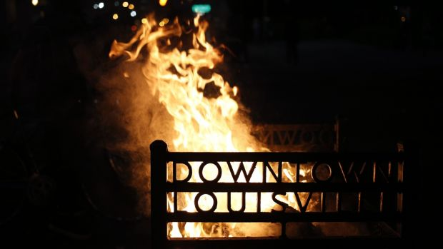 A rubbish bin on fire outside the Louisville Hall of Justice during a protest in Louisville, Kentucky in the US. Photographer: Luke Sharrett/Bloomberg