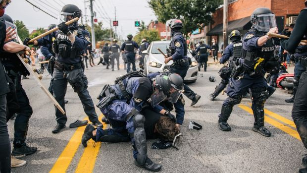 Protester detained by police during demonstration in Kentucky. Photograph: Getty