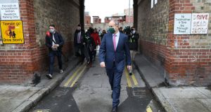 Taoiseach Micheál Martin on a visit the Oliver Bond flat complex in Dublin on Thursday. He said there was general rising trend of Covid-19 cases across the country.   Photograph: Julien Behal
