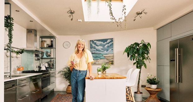 Isobel's kitchen features a moveable island and she has re-designed the right-hand side with floor-to-ceiling units and a larger fridge to accommodate her growing family's needs