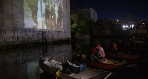 Canal plus film: Attendees in canoes at the Gowanus Dredgers paddle-in movie in Brooklyn, New York, on September 19th. Photograph: Paul Frangipane/Bloomberg