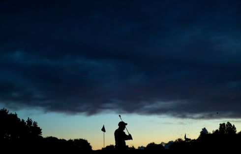 TEE UP: A golfer warms up ahead of his tee time at the Irish Open, in Ballymena, Co Antrim. Photograph: Tommy Dickson/Inpho