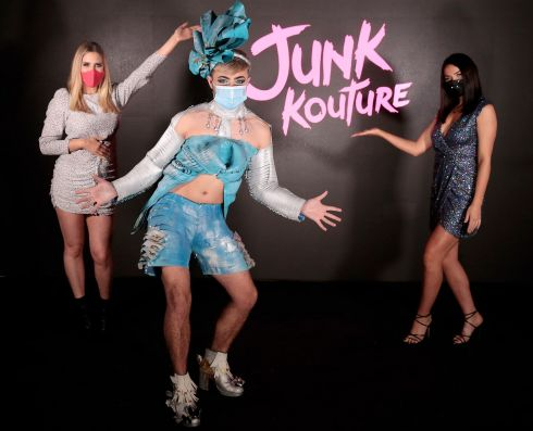 DRESS FOR SUCCESS: Junk Kouture finalist Cian Newman, from Dublin, models his design made from old roller blinds with Junk Kouture presenters Laura Fox and Emma Power. Photograph: Brian McEvoy