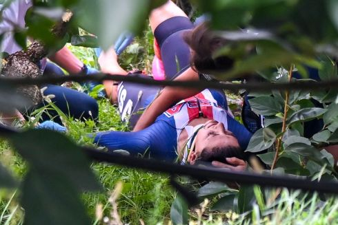 CYCLING ACCIDENT: Rescuers tend to Chloé Dygert Owen after she fell during a time trial at the UCI 2020 Road World Championships in Imola, Italy. Photograph: Marco Bertorello/AFP via Getty Images