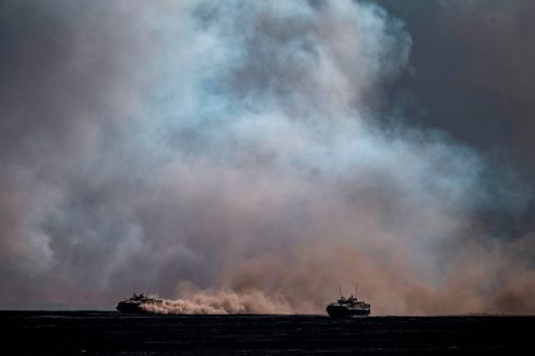 MILITARY PRECISION: Russian army tanks and armoured personnel carriers take part in military exercises at the Prudboy range in Volgograd region. Photograph: Dimitar Dilkoff/AFP via Getty Images