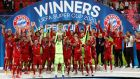 Bayern Munich celebrate their Uefa Super Cup win over Sevilla. Photograph: Bernadett Szabo/AP