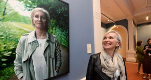 Prof Marie Cassidy stands beside her portrait by artist Jack Hickey at the National Gallery in 2018. Photograph: Cyril Byrne