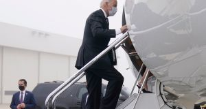 Democratic presidential candidate Joe Biden boards a plane in New Castle Airport, in Delware on Thursday, en route to Washington for Justice Ruth Bader Ginsburg's funeral. Photograph: Carolyn Kaster/EPA