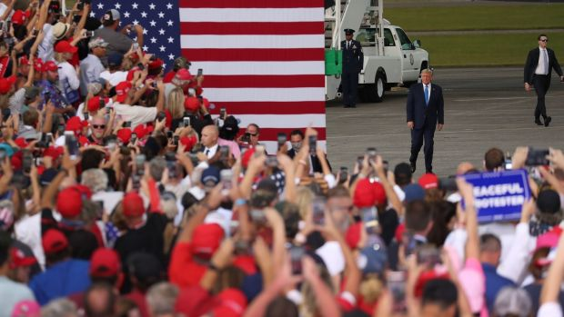 US president Donald Trump walks to the stage after arriving on Air Force One for his, 'The Great American Comeback Rally', at Cecil Airport on Thursday in Jacksonville, Florida. Photograph: Joe Raedle/Getty Images