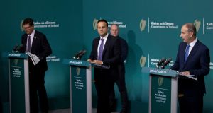 (From left to right) Minister for Transport  Eamon Ryan, Tánaiste Leo Varadkar and Taoiseach Micheál Martin. A few weeks ago Ministers were looking forward to an autumn of cautious reopening. Photograph: PA