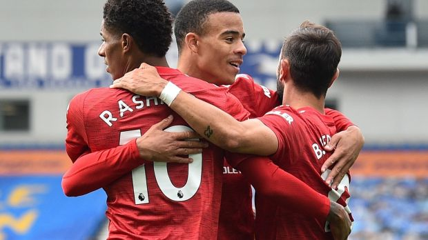 Mason Greenwood and Bruno Fernandes with Marcus Rashford after he gave Manchester United a 2-1 lead against Brighton. Photograph: Glyn Kirk/EPA