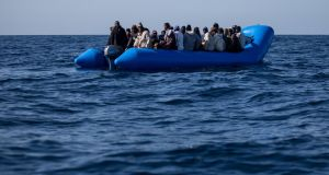 An inflatable boat off the Libyan coast. Over the past three years, tens of thousands of refugees and migrants have been caught trying to cross the Mediterranean Sea and detained without charge or trial. Photograph: Federico Scoppa/AFP/Getty