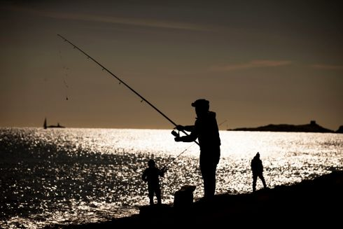 GOLDEN CATCH: People fishing on Sunday in Dún Laoghaire, Co Dublin. Photograph: Tom Honan