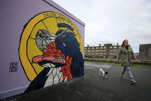 "PETS, SAINTS & SCHOLARS: A new mural paying tribute to President Michael D Higgins's late dog Síoda, by artist ""High King Jack"", depicts the President's pet as a saint. It is located in Ringsend and bears the legend ""Naomh Síoda - madra na hÉireann"", or ""Saint Síoda, dog of Ireland"". Photograph: Nick Bradshaw"