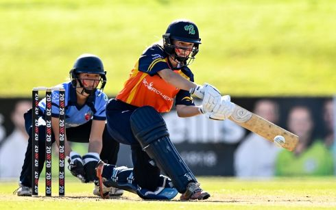 WOMEN'S SUPER SERIES: Leah Paul of Scorchers bats a shot, watched by Sarah Forbes of Typhoons, during the Women's Super Series match at Malahide Cricket Club in Dublin. Photograph: Sam Barnes/Sportsfile