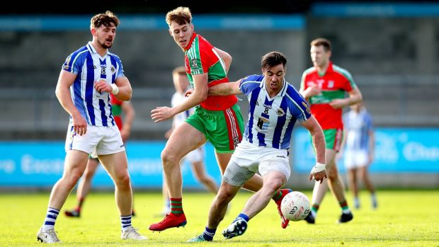 Ballyboden St Enda's Michael Darragh Macauley and Cameron McCormack of Ballymun Kickhams struggle for the ball. Photograph: Ryan Byrne/Inpho
