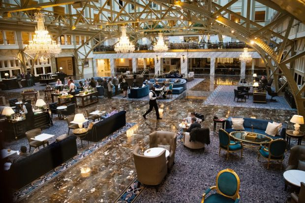 The lobby of the Trump International Hotel in Washington, a hotel which is loaded with debt and losing money. Photograph: Al Drago/The New York Times.