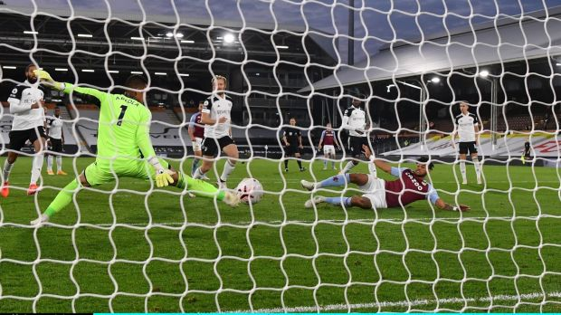 Tyrone Mings scores Aston Villa's third against Fulham. Photograph: Mike Hewitt/Getty