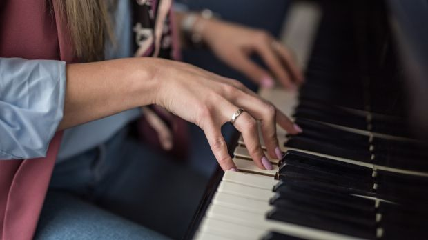 If you want to learn to play the piano, practise for a few minutes each lunchtime. Photograph: iStock