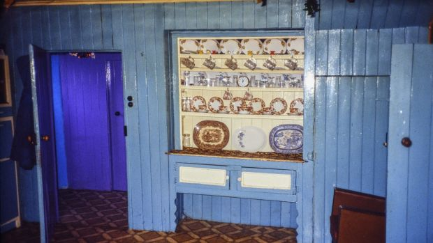 Recessed dresser built into a dividing wall of a farmhouse, with palest paintwork for the backing boards and panels. Photograph: Claudia Kinmonth, 1988, Co Cork