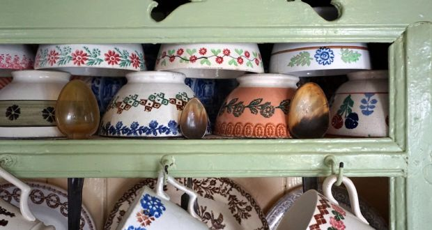 Spongeware printed 'basins' and horn spoons hung in eye-level slots, as was traditional up to the early 20th century, on a County Cork dresser. Photograph: M Duerden