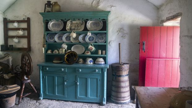 Dresser from Ballyveaghmore farm kitchen, with flour-bag ceiling and red half door. Photograph: Claudia Kinmonth, courtesy of the Ulster Folk Museum