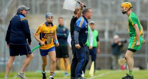 Sixmilebridge's coach Davy Fitzgerald argues with Niall Donovan of O'Callaghan Mills at the Clare Senior Hurling Championship final in Cusack Park, Ennis on Sunday. Photograph: James Crombie/Inpho