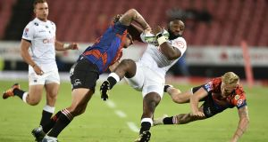 Tendai Mtawarira of the Cell C Sharks is tackled by Malcolm Marx (L) and Tyrone Green (R) of the Emirates Lions during their Super Rugby clash in April. Photo: Lefty Shivambu/Gallo Images/Getty Images