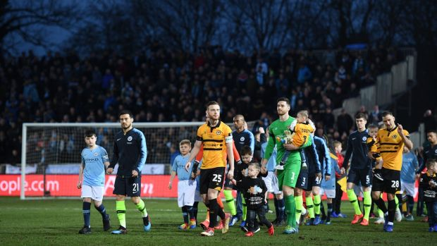 Mark O'Brien leads out Newport against Manchester City in the FA Cup in February 2019. Photograph: Harry Trump/Getty