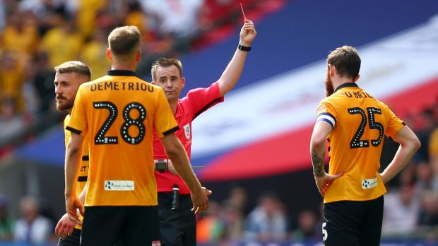 Mark O'Brien is shown a red card during the League Two play-off final against Tranmere. Photograph: Charlie Crowhurst/Getty
