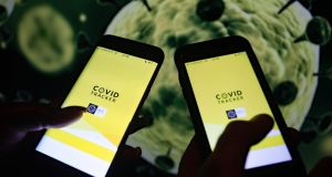 Two phones with the Covid Tracker  contact tracing app. Photograph: Niall Carson/PA Wire