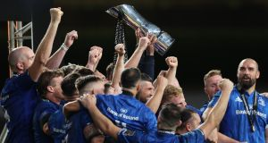 Leinster's Rob Kearney and Fergus McFadden lift the Guinness Pro 14 trophy after the victory over Ulster in the final at the Aviva Stadium in September. Photograph: Billy Stickland/Inpho
