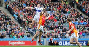 St Vincent's Diarmuid Connolly scores a goal despite the efforts of Castlebar Mitchels' Eoghan O'Reilly during the 2014 AIB  All-Ireland club football final at Croke Park. Photograph: Cathal Noonan/Inpho