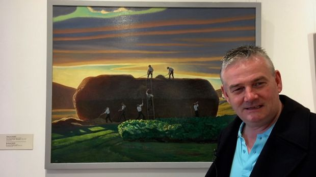 Kevin Magee with one of Rockwell Kent's Irish paintings in Ar Lorg Annie