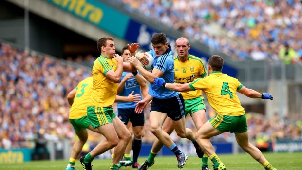 Dublin's Diarmuid Connolly is challenged by Eamonn McGee, Neil Gallagher and Paddy McGrath of Donegal during the 2014 All-Ireland SFC semi-final at Croke Park. Photograph: James Crombie/Inpho