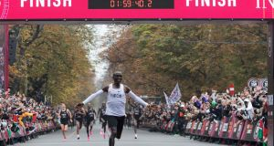 Kenya's Eliud Kipchoge celebrates as	he crosses the finish line after breaking the mythical two-hour barrier for the marathon in Vienna last October. Photograph:    Alex Halada/AFP via Getty Images