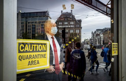 MASK UP: The wax figure of US president Donald Trump has been 'quarantined' at Madame Tussauds by putting a face mask and a placard in the window of Tussauds on the Dam, in Amsterdam, the Netherlands. Trump and his wife Melania have been infected with Covid-19 and have gone into self-isolation at the White House. Photograph: Koen van Weel/EPA