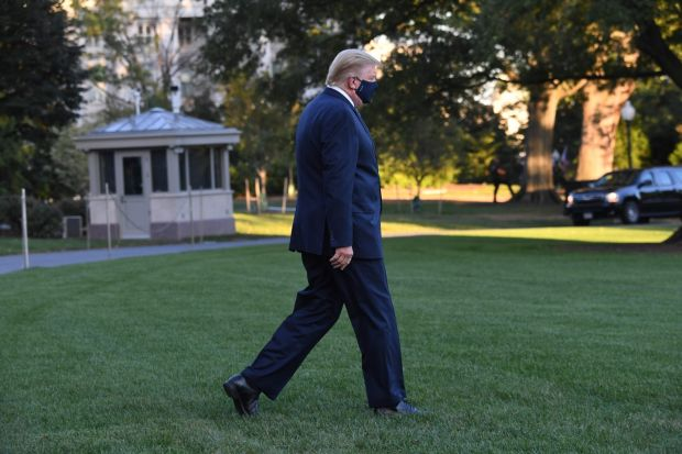 US president Donald Trump walks to Marine One prior to departure from the South Lawn of the White House in Washington DC as he heads to Walter Reed Military Medical Center after testing positive for Covid-19 on Friday. Photograph: Saul Loeb/AFP via Getty